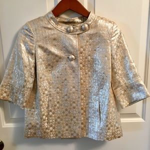 Champagne colored metallic jacket with pockets.